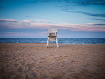 Rehoboth Beach Lifeguard Chair. Lifeguard chair at Rehoboth Beach at sunset stock photo