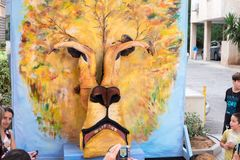 Lion face maked by two painted girls - participants of Rehovot International Live Statues Festival. REHOVOT, ISRAEL - JULY 4, 2018: Lion face maked by two royalty free stock photo