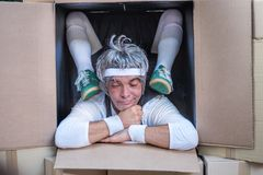 Very flexible man in carton box - undefined participant of Rehovot International Live Statues Festival royalty free stock images
