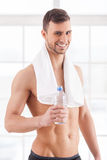 Rehydrating after workout. Royalty Free Stock Photography