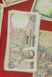 Rei tailandês Bhumibol Adulyadej do vintage em cédulas Baht tailandês velho Imagens de Stock Royalty Free