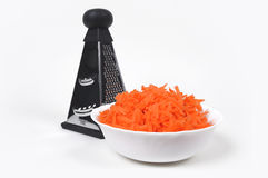 Reibe und zerriebene Karotten Stockfotos