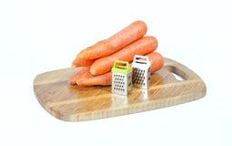 Reiben und Karotten stockfotos