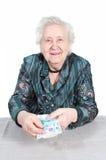 Reiche Großmutter mit Geld. Stockfoto