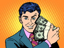 Reiche mit Packs von Dollar Die goldene Taste oder Erreichen für den Himmel zum Eigenheimbesitze Lizenzfreie Stockfotografie