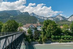 Free Reichenau Castle And Bridge Over The Rhine With The Swiss Alps In The Background Stock Images - 154688074