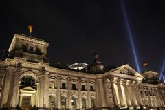 Reichstag at 20th Jubilee of the Wall's Fall. On November 9th 2009 happened the Celebration of the Fall of Berlin Wall. The Spotlight in the Background is part Royalty Free Stock Photo