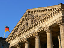 Reichstag Berlin. Detail shot of german parliament in Berlin with german flag Royalty Free Stock Photos