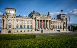 Reichstag Berlin. With green lawn and German flag Stock Photos
