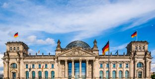 Reichstag in Berlin. Reichstag houses of parliament in Berlin, Germany - Dem Deutschen Volke means To The German People Royalty Free Stock Photo