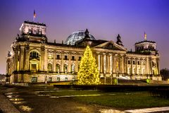 Reichstag in berlin in winter at night with christmas tree Royalty Free Stock Photo