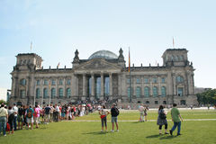 Reichstag building. Row of people in front of the Reichstag building in Berlin Stock Photos
