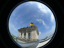 Reichstag building Berlin. Exterior of Reichstag building with blue sky background, viewed trough fish eye lens Stock Images