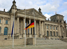 Reichstag building in Berlin with flag at half mast. The big tex Stock Photography
