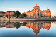 The Reichstag building Bundestag with reflection in river Spre Royalty Free Stock Photos