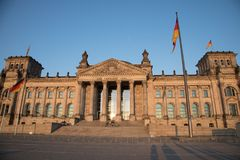 Reichstag building with flag poles in foreground Stock Image