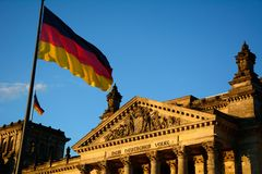 Reichstag building. The german Reichstag building in berlin with flag in front Stock Images