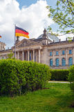 Reichstag Building and German Flag, Berlin Stock Photo