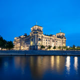 The Reichstag building at night in Berlin Stock Photography