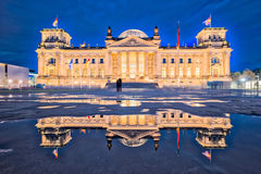 The Reichstag building at night in Berlin. The dedication Dem d. Eutschen Volke, meaning To the German people, can be seen on the frieze stock images