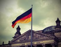 Reichstag building is Parliament of Germany in Berlin with flag. Royalty Free Stock Photo
