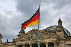 Reichstag building in Berlin with flag. The dedication text DEM Stock Photos