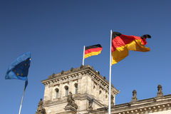 Reichstag with german and european flags Stock Photos