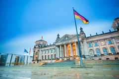 Reichstag view with German flag after rain stock photography