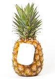 Reife Ananas mit einem Preis Stockbilder