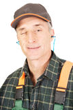 Reife Arbeitskraft blinkt sein Auge Stockfotos