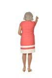 Reife Frau im rosa Kleid Stockbilder