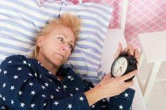 Reife Frau mit Schlaflosigkeit Stockfotografie