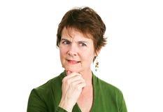 Reife Frau - Ungewissheit Stockfoto