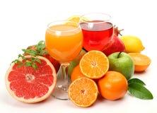 Reife Frucht und Saft Stockfotos