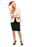 Reife Geschäftsfrau, die Sankt-Hutweihnachtenlächelndes isolat trägt lizenzfreies stockbild