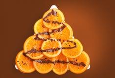 Reife Orangen mit Schokolade Stockfotos
