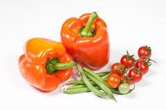 Reife Tomaten, orange Pfeffer und grüne Bohnen Stockfoto