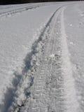 Reifenspur im Schnee Lizenzfreie Stockfotos
