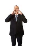 Reifer Geschäftsmann, der jemand fordert Lizenzfreies Stockbild