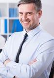 Reifer Geschäftsmann mit Schönheitslächeln Stockbilder