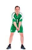 Reifer Mann gekleidet in der grünen Sportkleidungsaufstellung Stockfoto