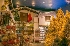 The reign of Santa Claus: beautiful christmas shop with balls, tree and decorations Stock Photos