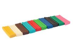 Reihe der farbigen Plasticineziegelsteine Lizenzfreies Stockfoto