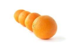 Reihe der Orangen Stockfotos