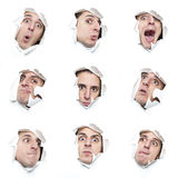 Reihe Gesichter, die durch Löcher im Papier schauen Stockbilder