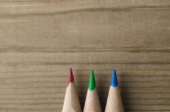 Reihe von Bleistiften im Rot, im Grün und im Blau Lizenzfreie Stockbilder