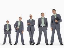 Reihe von Geschäftsmännern in aufsteigender Sequenz der Höhe Lizenzfreie Stockfotografie