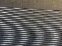 Reihen von filmy Gewächshäusern auf dem Gebiet Wachsendes Gemüse in einem geschlossenen Boden Gewächshäuser auf dem Gebiet Lizenzfreie Stockfotografie
