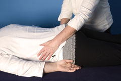 Reiki. A young woman is getting a reiki treatment stock photo