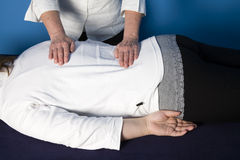 Reiki. A young woman is getting a reiki treatment royalty free stock image